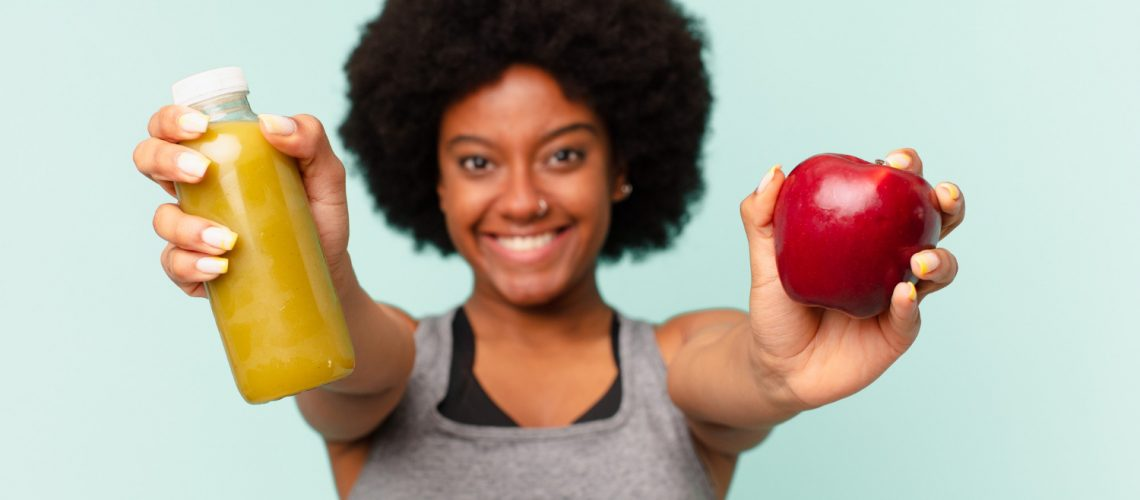 black-afro-fitness-woman-with-a-smoothy