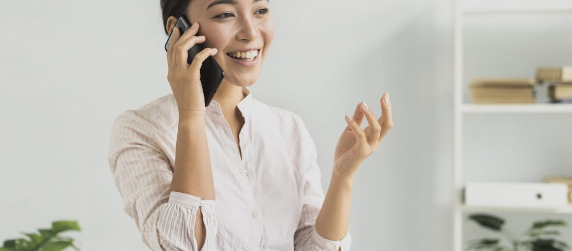 portrait-smiley-woman-talking-over-phone